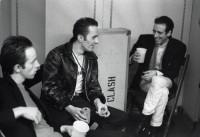 HAMBURG, GERMANY - MAY 12: The Clash relax backstage at the Musikhalle in Hamburg, Germany on May 12 1981 L-R Topper Headon, Joe Strummer, Mick Jones (Photo by Ellen Poppinga - K & K/Redferns)